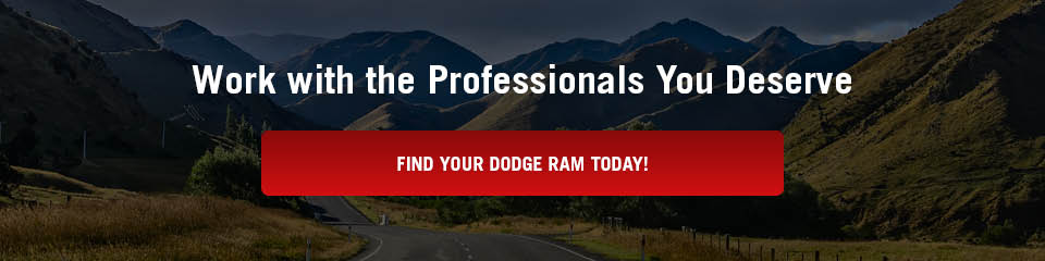 A banner that says 'Work with the Professionals You Deserve' with a red button that says 'Find Your Dodge Ram Today!'. A photo of a mountain road is in the background.