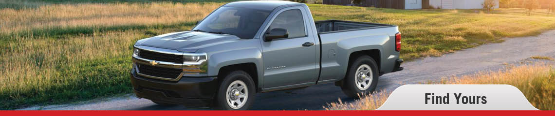 A banner showing a gray Chevy Silverado driving along a grass-lined path at dusk, with the words 'Find Yours' in the lower right corner. On mouseover, the banner changes to show a gray Ram 1500 in front of a grassy field.