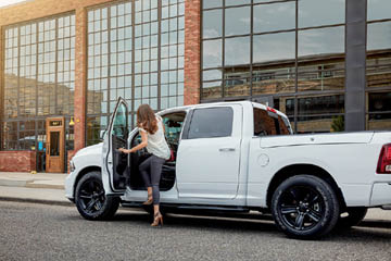 Steinbach Dodge - Woman In RAM 1500